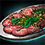 Plate of Beef Carpaccio with Mint Garnish.png