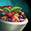 Bowl of Fruit Salad with Mint Garnish.png