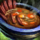 Bowl of Spiced Meat and Cabbage Stew.png